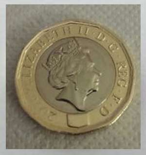 Error E - An Absence of the hologram on the shield on the new one pound coin